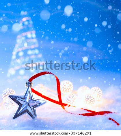 christmas light decoration on blue snow background