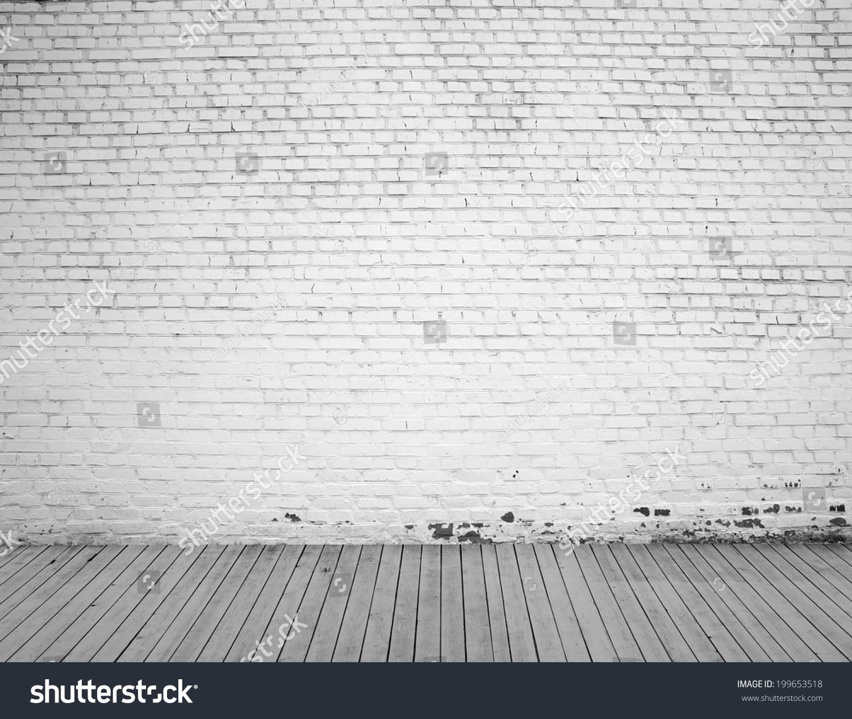 白色砖墙和木地板的背景