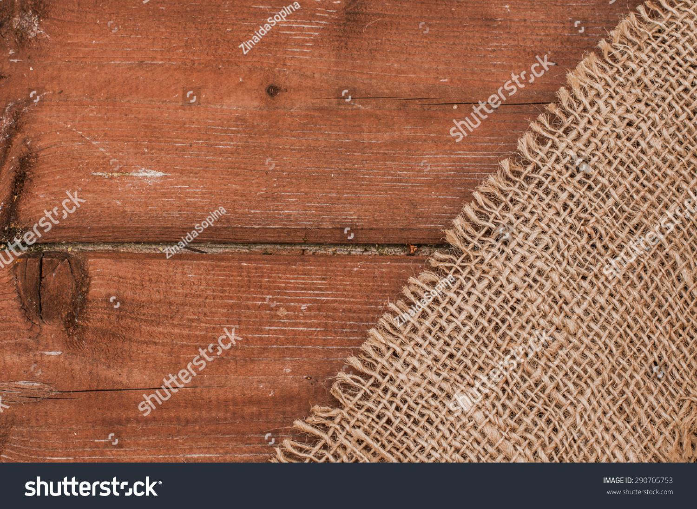 粗麻布纹理背景木制的桌子上-背景/素材